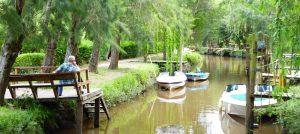 Man relaxing by Tigre Delta waterway