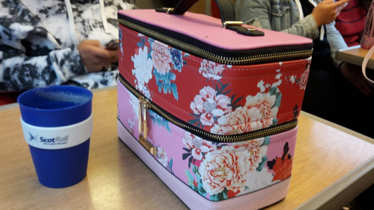 Essentials of travel – a keep cup and make-up bag